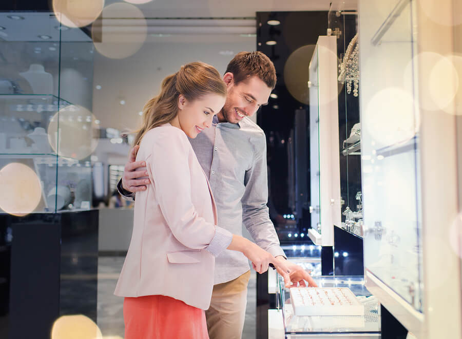 Couple shopping for the perfect engagement ring; Lavalier Jewelry Insurance