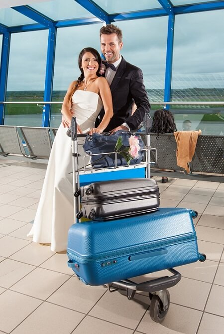 Young Couple, just married, traveling with jewelry